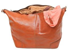 Leather handbag with blouse and pink lace panties Stock Photos