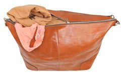 ajar leather bag with blouse and pink lace panties - stock photo