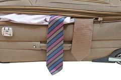 two ties from ajar suitcase - stock photo