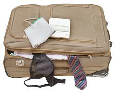 Sphygmometer on suitcase with tie and bra Stock Photos