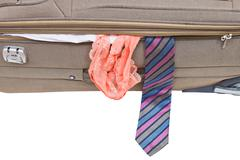 Male tie and female panties from suitcase Stock Photos