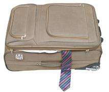 ajar textile suitcase with male tie isolated - stock photo