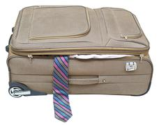 Textile suitcase with fell out tie isolated Stock Photos
