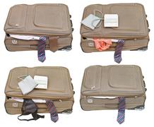 Set of suitcases with ladies and business clothes Stock Photos
