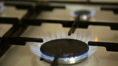 Burners on the gas stove in the kitchen Stock Footage