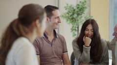 Woman in group therapy session talks about her problems as the others listen - stock footage