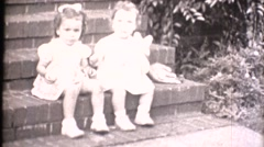 Middle America ,1949, toddlers on the porch Stock Footage
