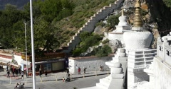 4k tourist visit potala in Lhasa,Tibet.busy traffic & white stupa. Stock Footage