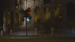 Timelapse Great Colosseum forum traffic street night busy road Rome people car Stock Footage