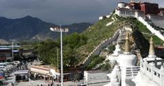 4k tourist visit potala in Lhasa,Tibet.busy traffic & white stupa. Stock Footage