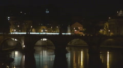 Old downtown Rome traffic street Vittorio Emanuele bridge night water reflection Stock Footage
