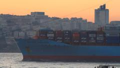 Container ship sailing past sunset Stock Footage