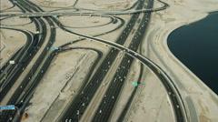Stock Video Footage of Aerial Dubai Intersection Dubai Creek desert Al Khail Road UAE