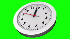 Clock ticking on green background Stock Footage