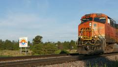 Train passes Arizona State Sign Stock Footage
