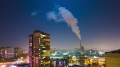Smoke from the industrial pipe to the atmosphere in the city at night, REAL TIME Stock Footage