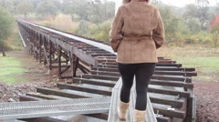 Walking on a Flume playing with danger - stock footage