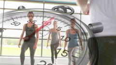 Stopwatch graphic over step aerobics class Stock Footage