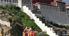 4k tibetan bride do a variety of positions in front of potala in Lhasa,Tibet. Stock Footage
