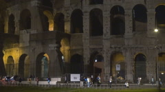 Tourist people visit Great Colosseum forum ancient ruin Rome iconic place night  Stock Footage