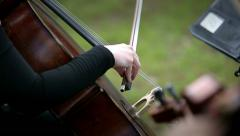 Musician playing violoncello on the street Stock Footage