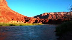 Colorado River among the steep mountains of red sandstone Stock Footage