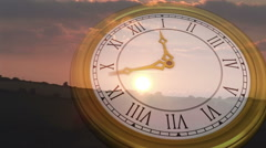 Clock ticking against sun setting Stock Footage