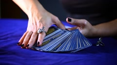 Woman Hand is Choosing a Tarot Card and Opening to Look for the Future Stock Footage
