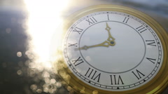 Clock ticking against sun on the sea Stock Footage