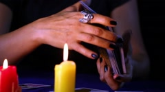 Woman Hand Mixing the Tarot Cards in Candle Light Stock Footage
