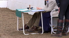 Horse dressage competition judges and rider Stock Footage
