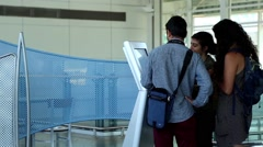 People checking map at direction sign inside yvr airport Stock Footage