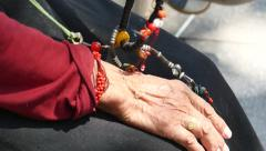 4k closeup of old tibetan woman prayer buddha beads. Stock Footage
