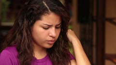 Beautiful Latina Girl Runs Hand Through Hair and Answers Cell Phone - stock footage