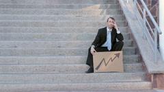 Businessman Sits On Steps Economic Arrow Stock Footage