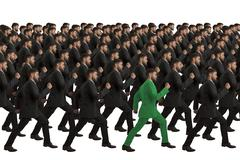 marching clones with green individual, studio shot - stock illustration