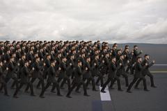 Marching clones, studio shot Stock Illustration