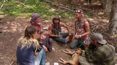 Hippies smoke marajuana at rainbow family gathering in utah Stock Footage