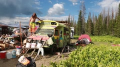 Hippie buses at rainbow family gathering at utah Stock Footage
