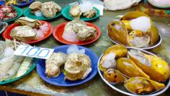 Fresh shellfish at banzaan seafood market, patong, phuket, thailand Stock Footage