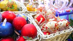 Christmas decorations for sale on a market stall. Stock Footage
