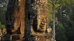 Twin faces of ancient religious monument at bayon temple Stock Footage