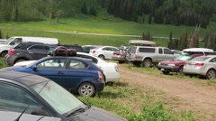 Cars parked at the rainbow family gathering in heber utah 2014 Stock Footage