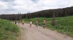 People hiking to the rainbow family gathering in heber utah 2014 Stock Footage