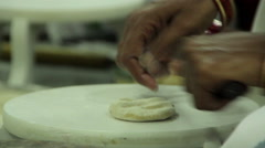Indian woman rolls chapatis Stock Footage