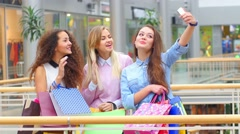 Group of happy best friends with shopping bags taking a selfie in the city  - Stock Footage