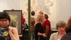 People briskly examine exhibits of the exhibition which opened in Moscow Stock Footage