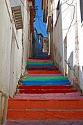 Multi colored steps in turkish village street. Stock Photos