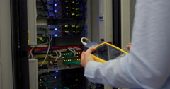 Technician using digital cable analyzer on server Stock Footage