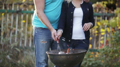 Couple make fire in barbecue Stock Footage